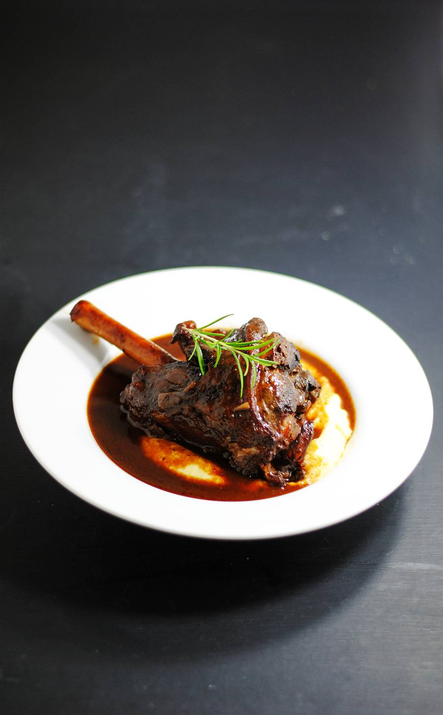 Braised Lamb Shanks With Creamy Polenta White Plate